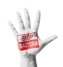 Open hand raised, Stop Bacteria sign painted, multi purpose conc